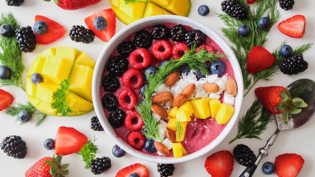bowl full of fruit and almonds