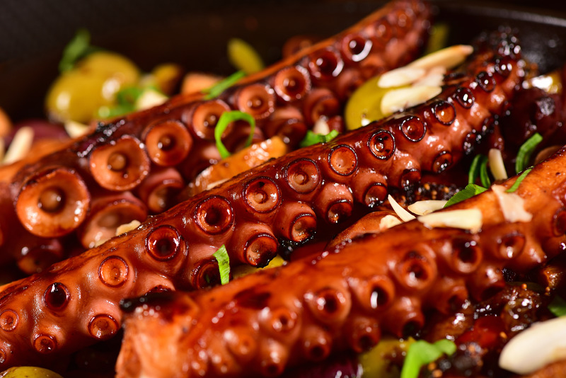 Grilled octopus with mushrooms and olives